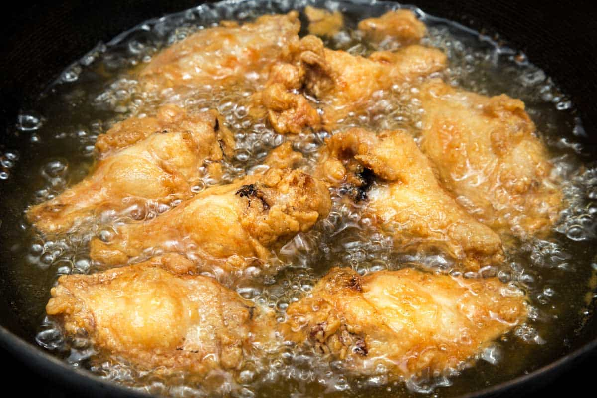 Chicken wing deep fried on hot vegetable palm oil, Can You Reuse Oil After Frying Raw Chicken?