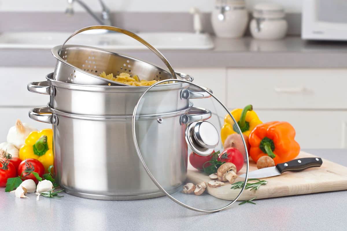 A double boiler with bell peppers and spices at the side, Should the Water in a Bain-Marie (Double Boiler) Be Hot?