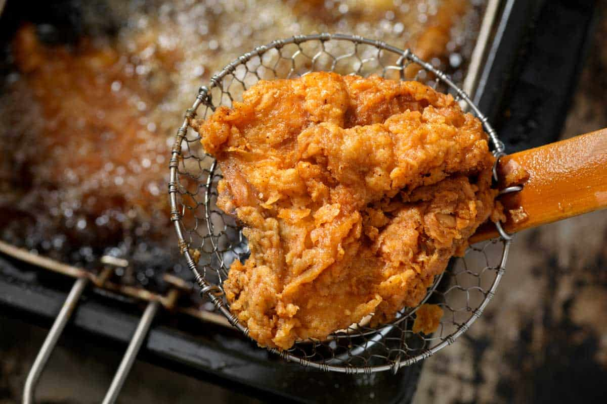 A fried chicken in a deep fryer