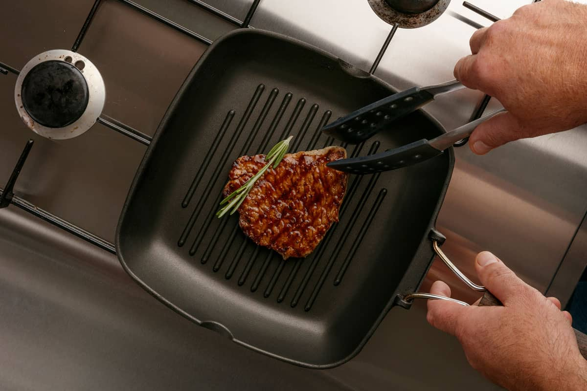 Cooking small piece of beef and rosemary on griddle, Can You Use a Griddle on a Gas Stove (and How)?