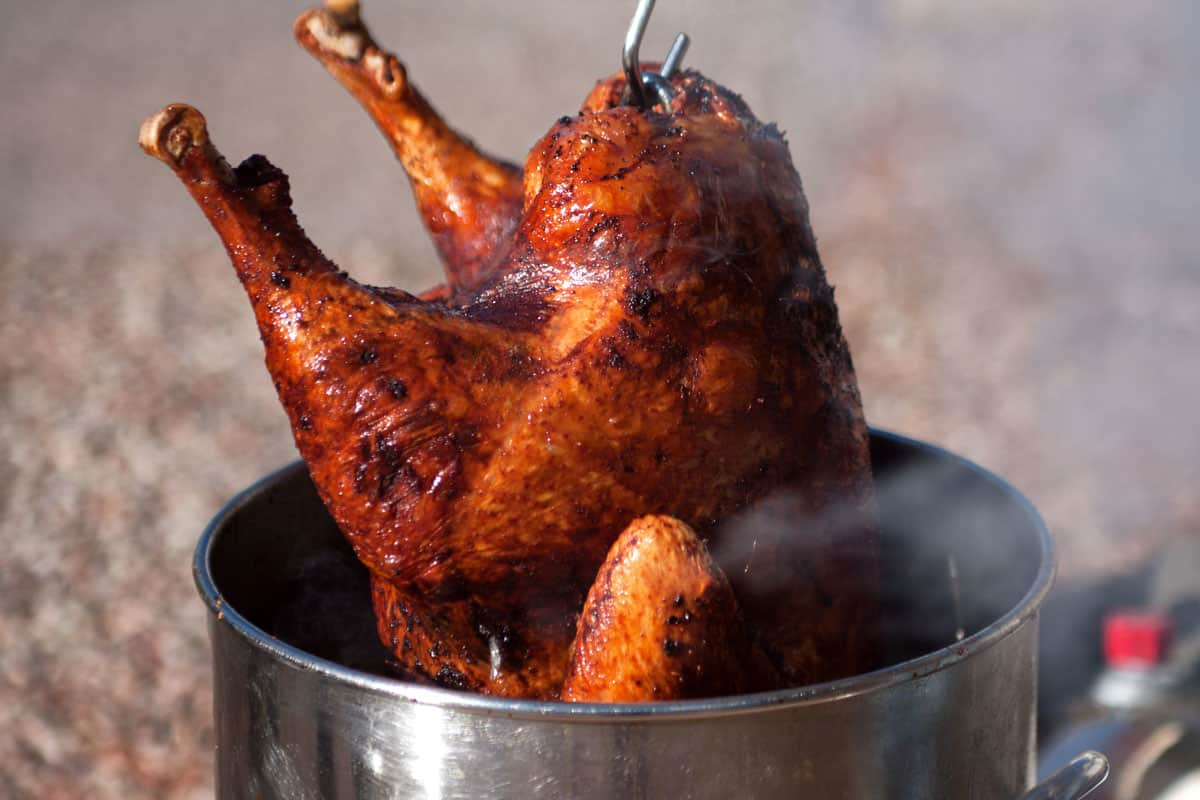 Delicious fried turkey hauled out of deep fryer, How Big of a Turkey Can Fit in a 30 Quart Fryer?