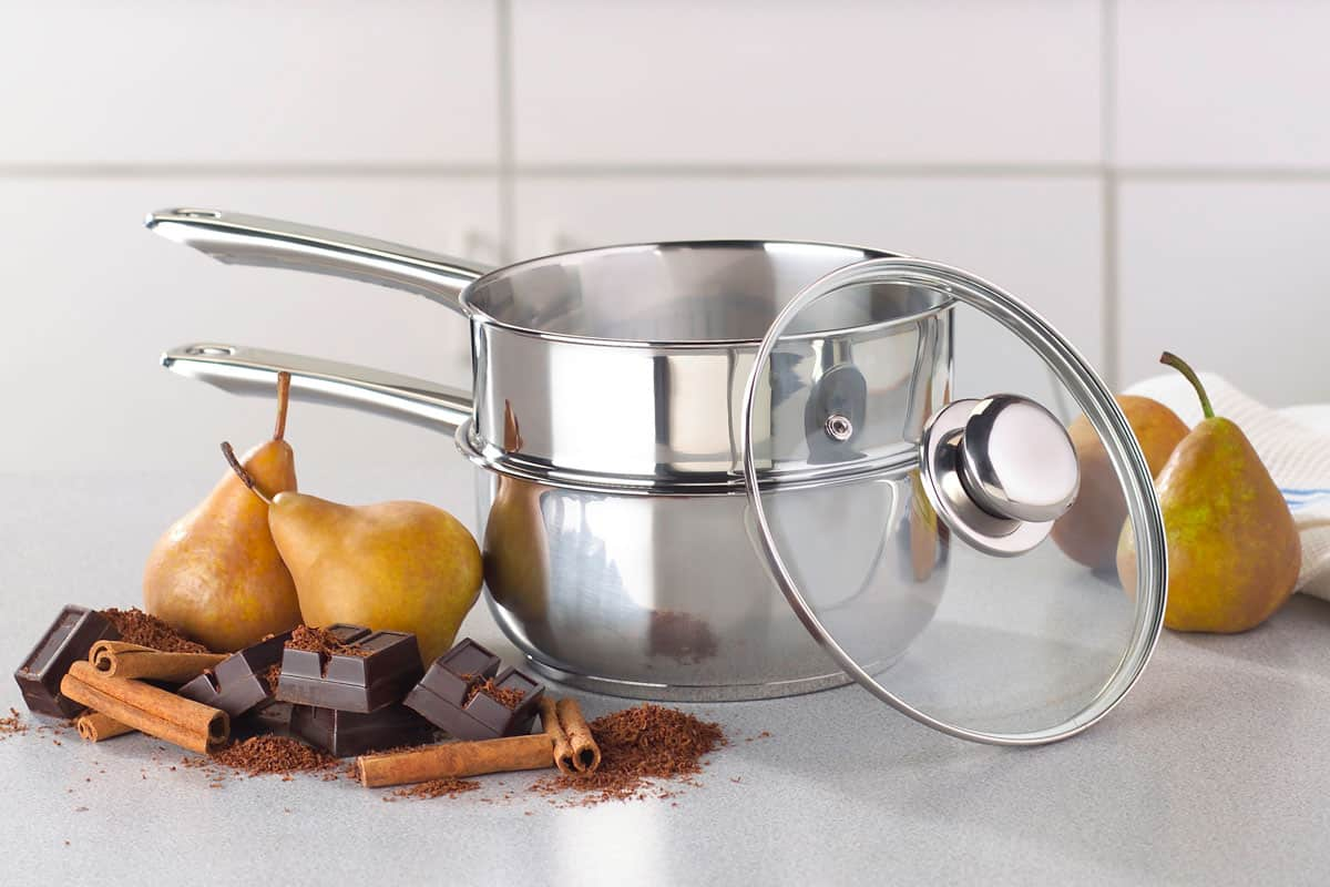 Double boiler at kitchen with pears chocolates and cinnamon rolls at the side, Is a Double Boiler (Bain Marie) Supposed to Touch the Water?