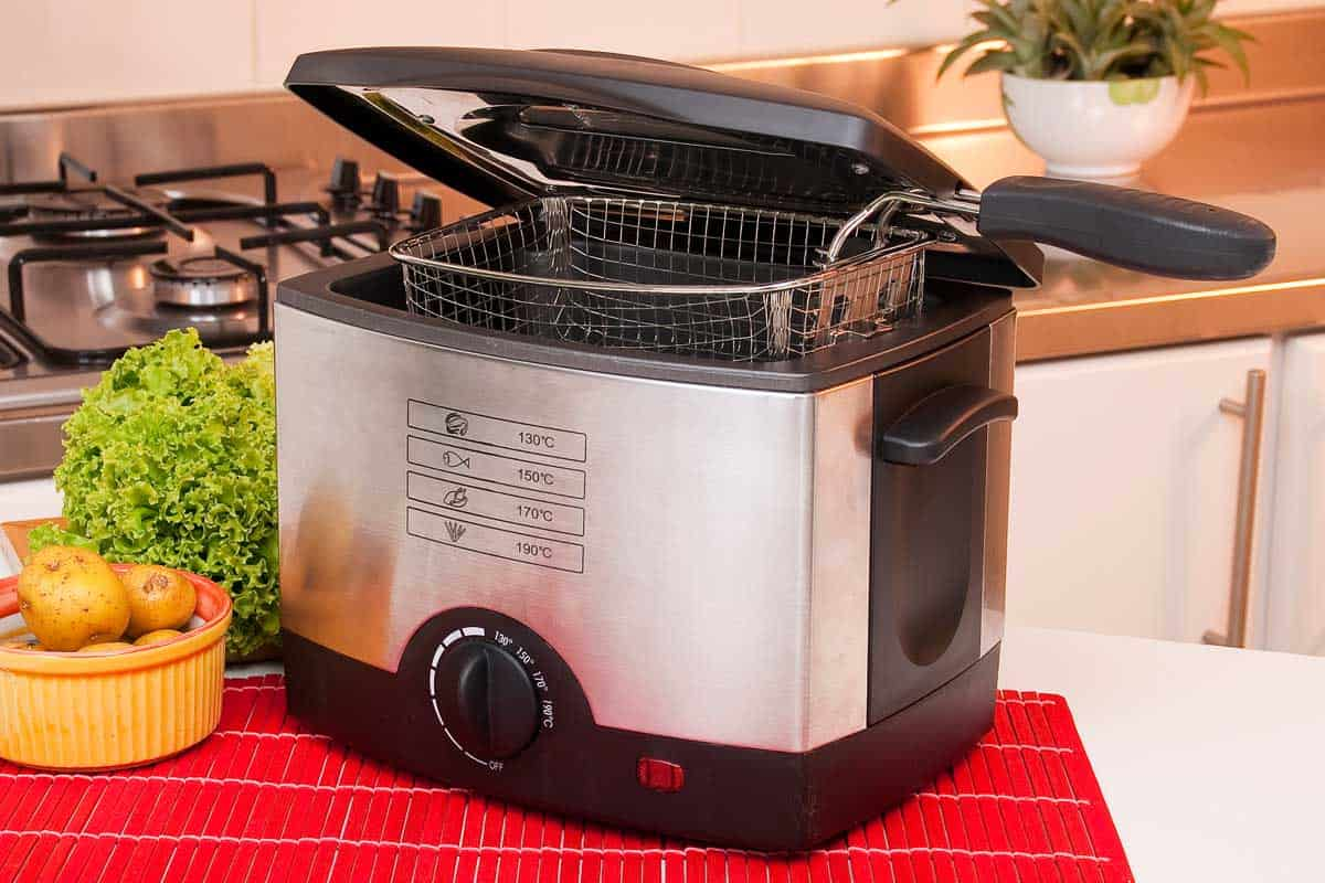 Electric frying pot with potatoes and lettuce in the kitchen, Top 10 Deep Fryers At Walmart