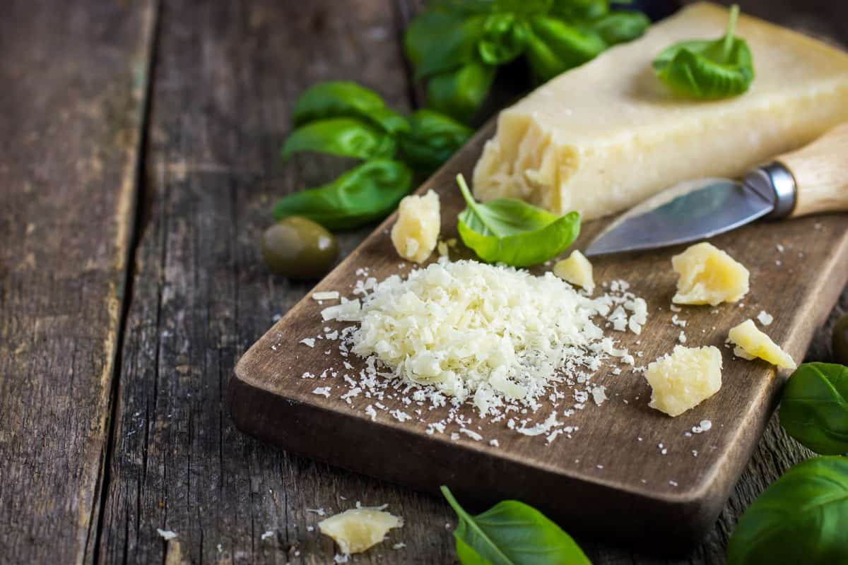 Grated parmesan cheese on chopping board