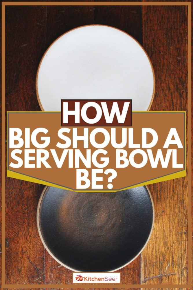 Black and brown bowl placed on wooden table, How Big Should A Serving Bowl Be?