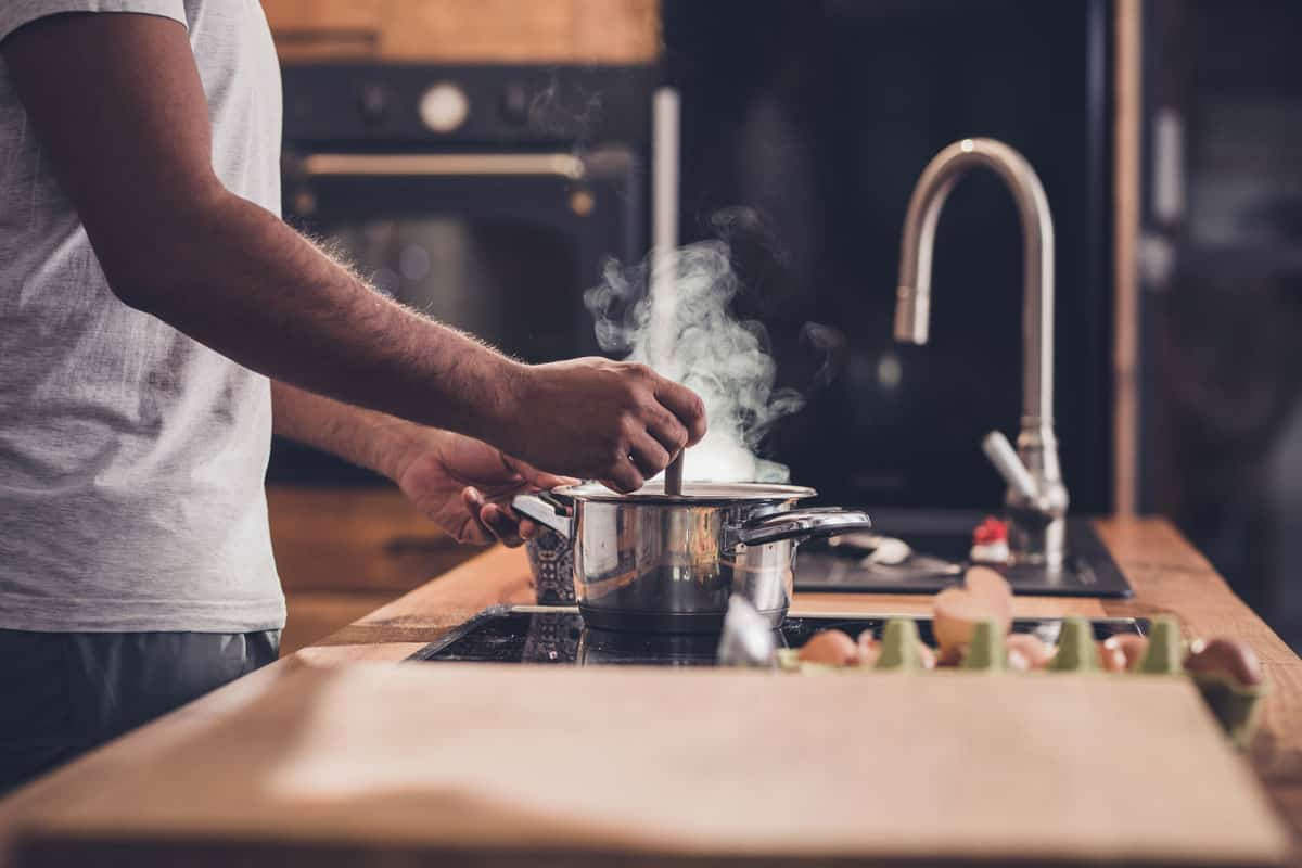 Man cooking soup in a stainless steel bowl, Can You Put Hot Food In Stainless Steel Bowls?