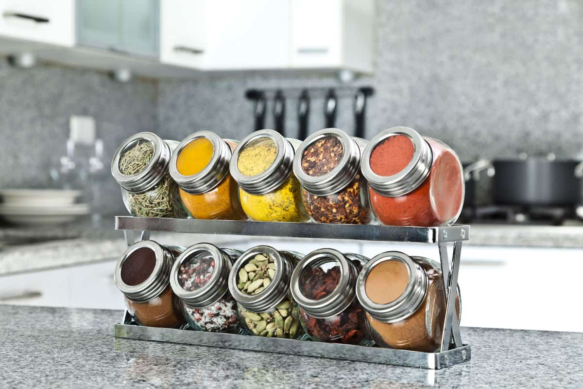 All sorts of spices placed on a spice rack for good display, 13 Unique Gifts For Cooking Enthusiasts