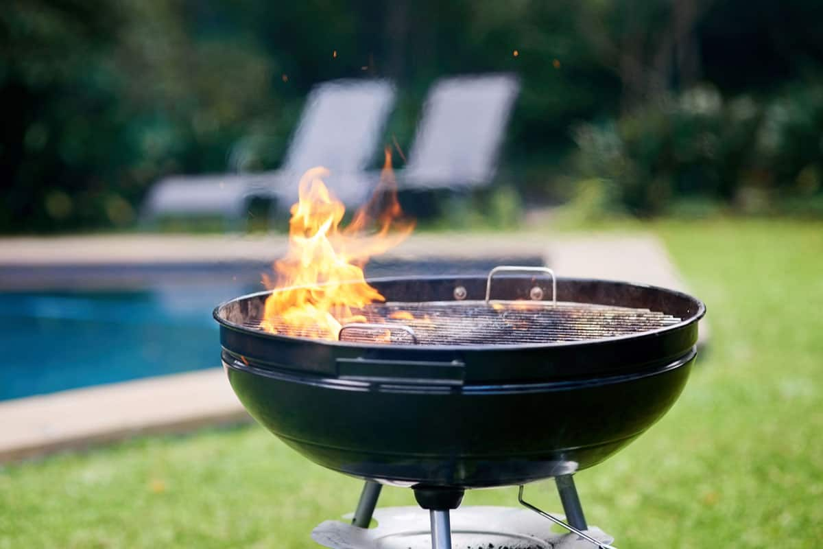 BBQ grill with flame burning at grill, 14 Luxury BBQ Gift Ideas For The Man Who Has It All