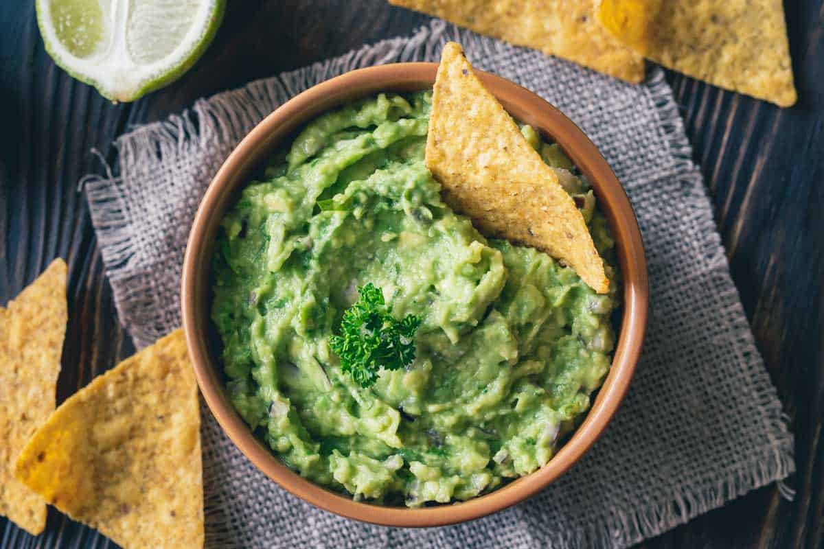 Bowl of guacamole with tortilla chips, 12 Gorgeous Individual Chip And Dip Bowl Ideas