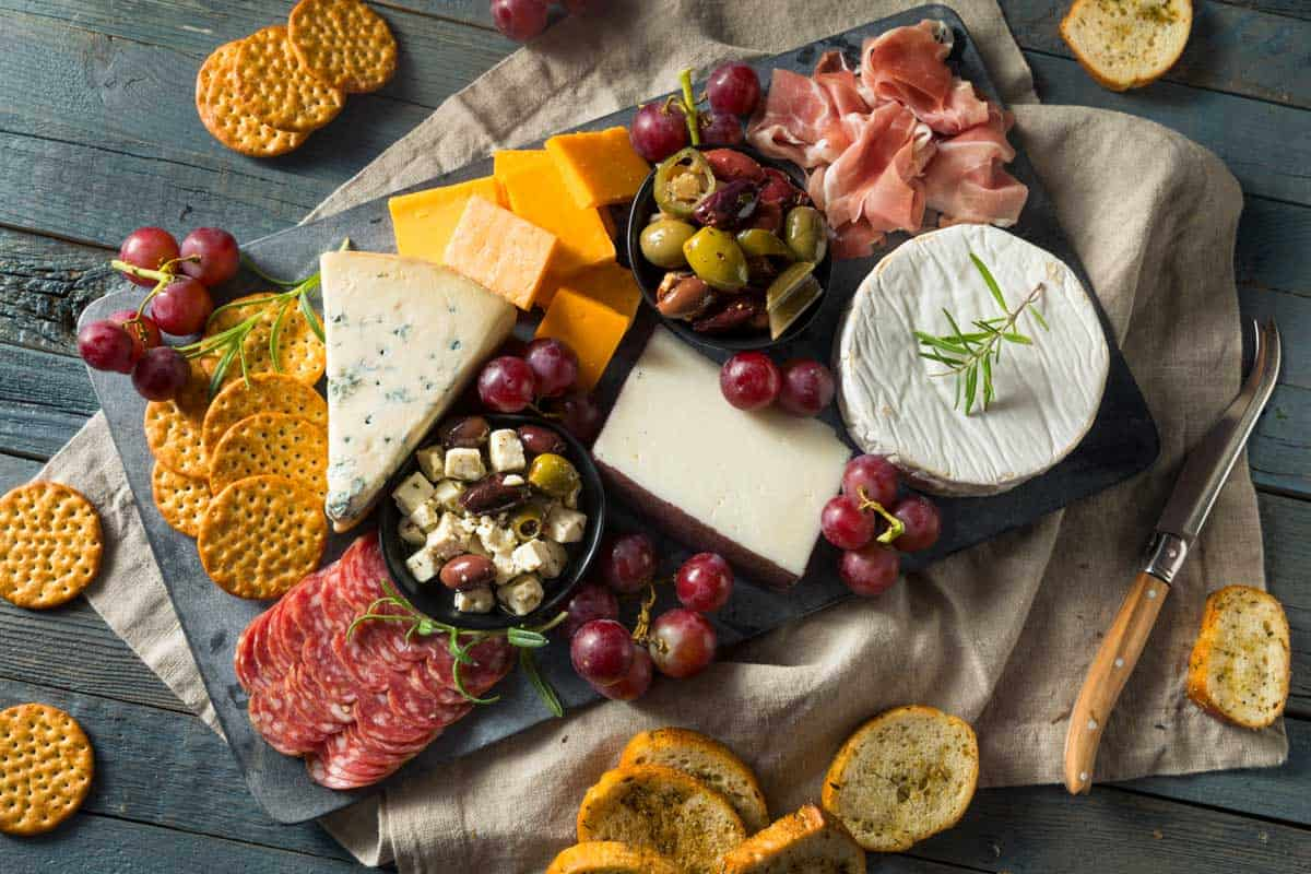 Gourmet Fancy Charcuterie Board with Meat Cheese and Grapes, What Do You Serve With Cheese Boards?