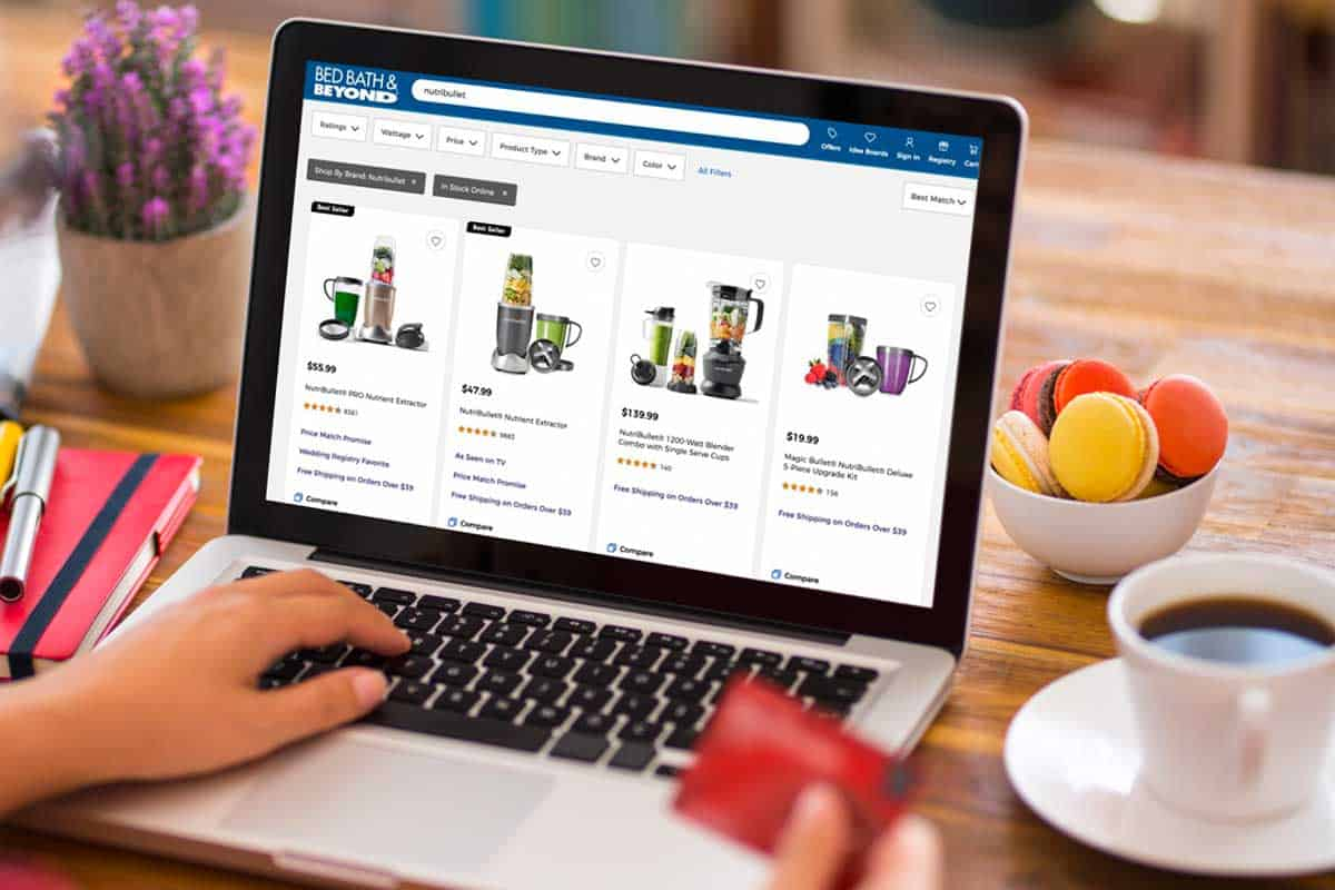 Person shopping online using a laptop holding a credit card, Where To Buy The NutriBullet [Top 25 Online Stores]