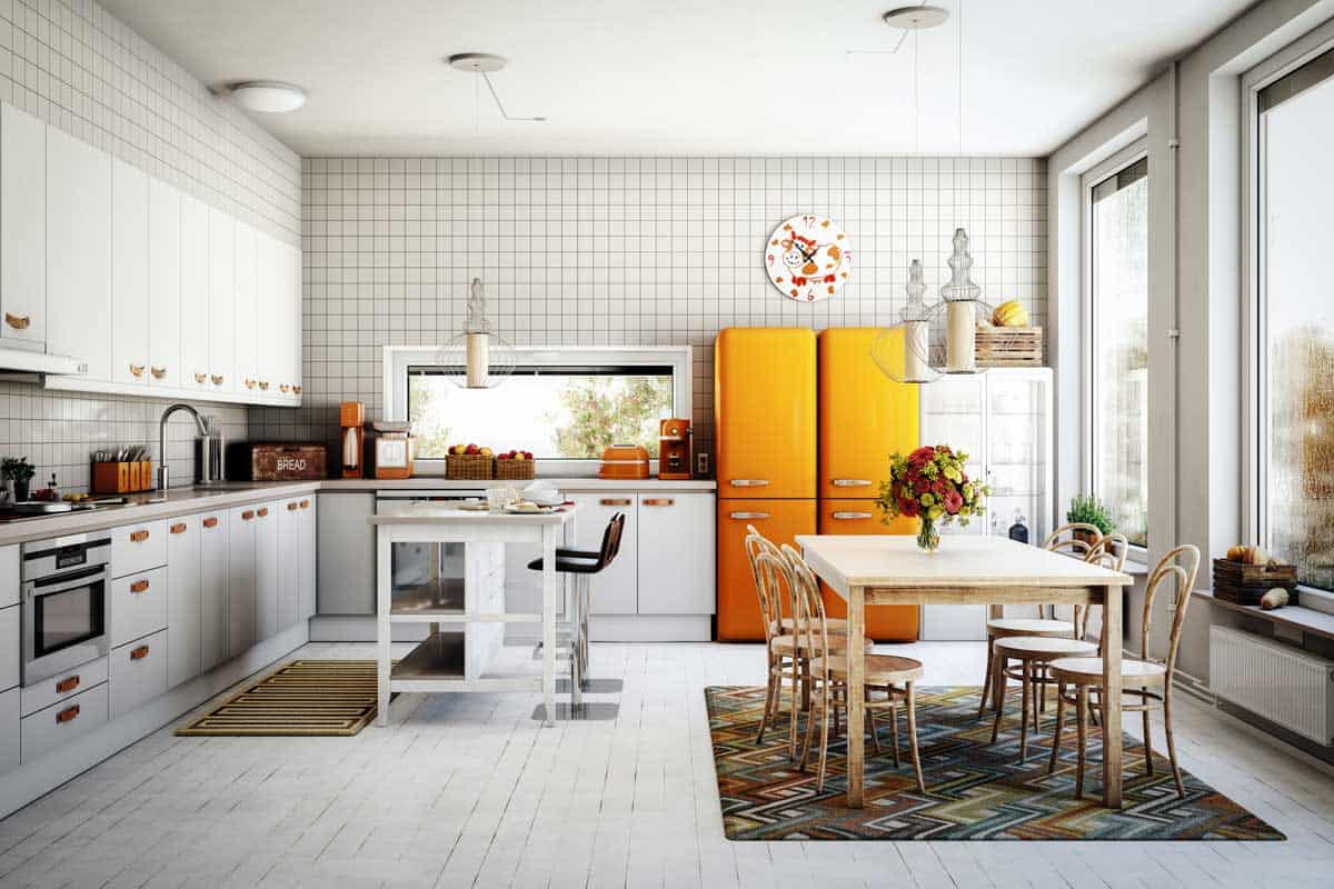 Scandinavian domestic kitchen interior scene with orange refrigerator, Where To Place A Refrigerator In A Kitchen [3 Crucial Considerations]