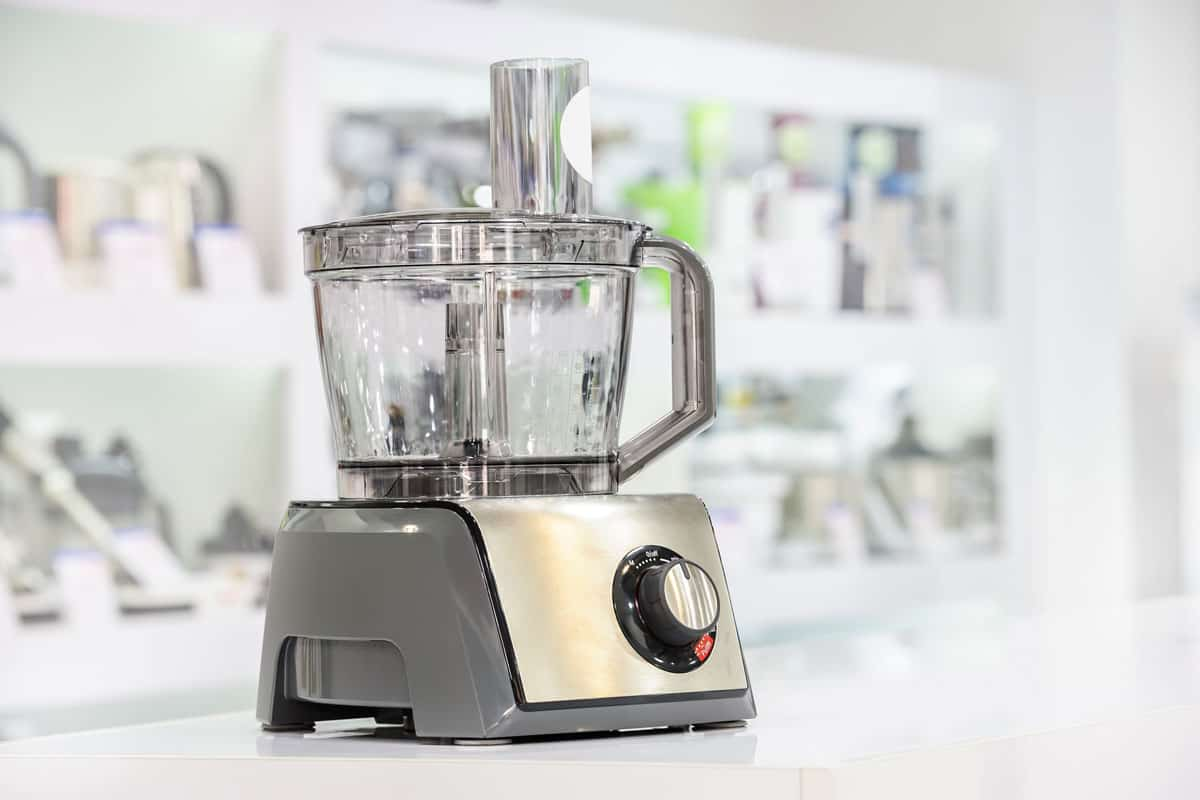 Silver food processor placed on white granite counter top, Kitchen Aid Food Processor Not Working - What Could Be Wrong?