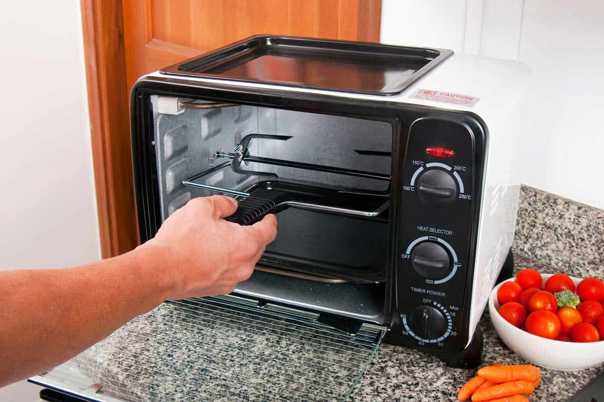 Household appliance; toaster oven, photo in kitchen environment, Can a Toaster Oven Replace A Microwave?