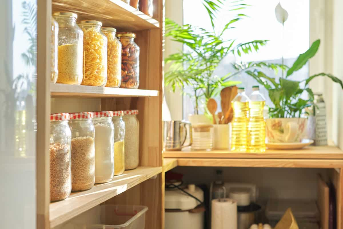 A pantry with organized jars with a window for ventilation, Does a Pantry Need Ventilation? [3 Times When the Answer is yes]