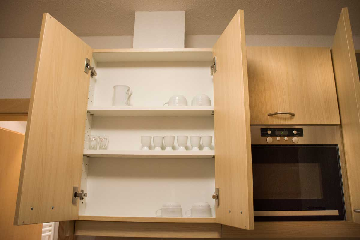 Kitchenware and cupboard in drawer of europe style kitchen room, How to Adjust Kitchen Cupboard Doors