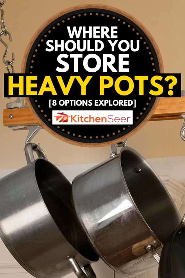 Modern kitchen with rack of hanging pots and pans, Where Should You Store Heavy Pots? [8 Options Explored]