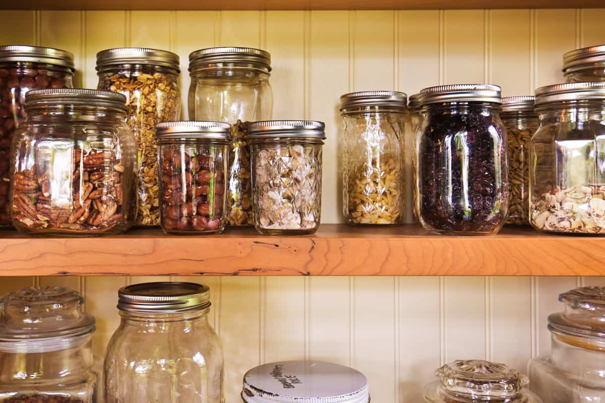 A pantry filled with spices and jars cooking ingredient inside, How to Organize a Pantry with Deep Shelves [6 Easy-to-follow Tips]