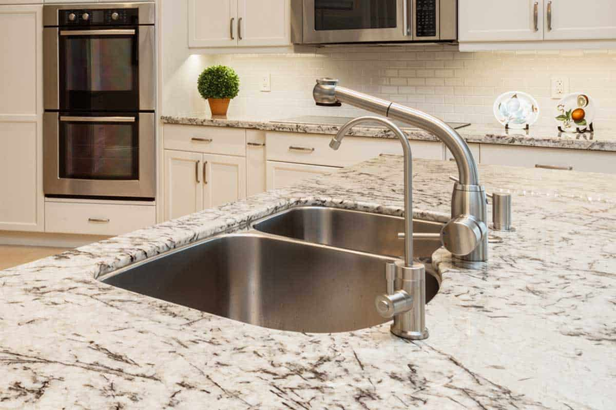 Beautiful home kitchen sink with granite countertops, Do Granite Countertops Need To Be Sealed [And How To Do That]