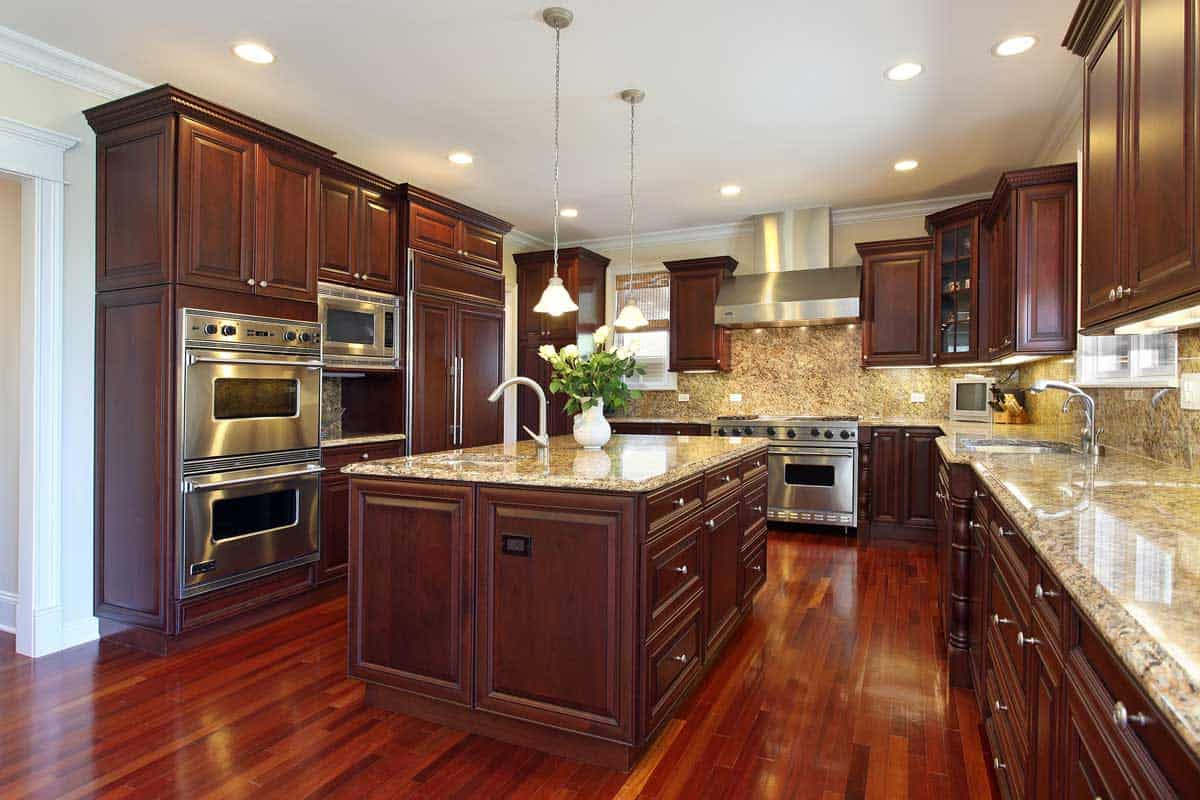 Kitchen with cherry wood cabinetry, Are Kitchen Cabinets Considered Furniture or Fixtures