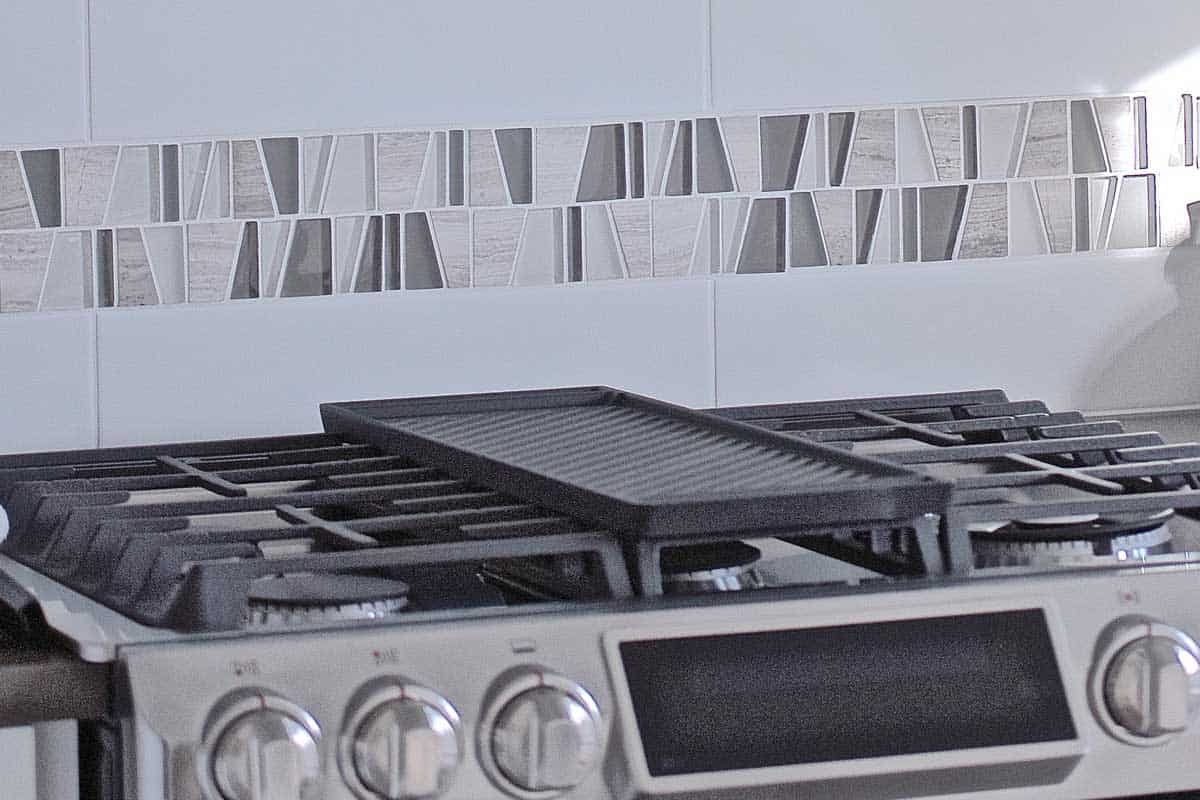 Modern kitchen gas stove with grill, How To Clean Gas Stove-Top Cast Iron Grates?