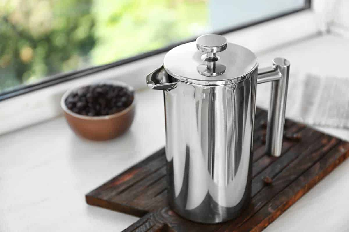 New coffee maker on cutting board on windowsill, How Do You Clean the Inside of a Percolator