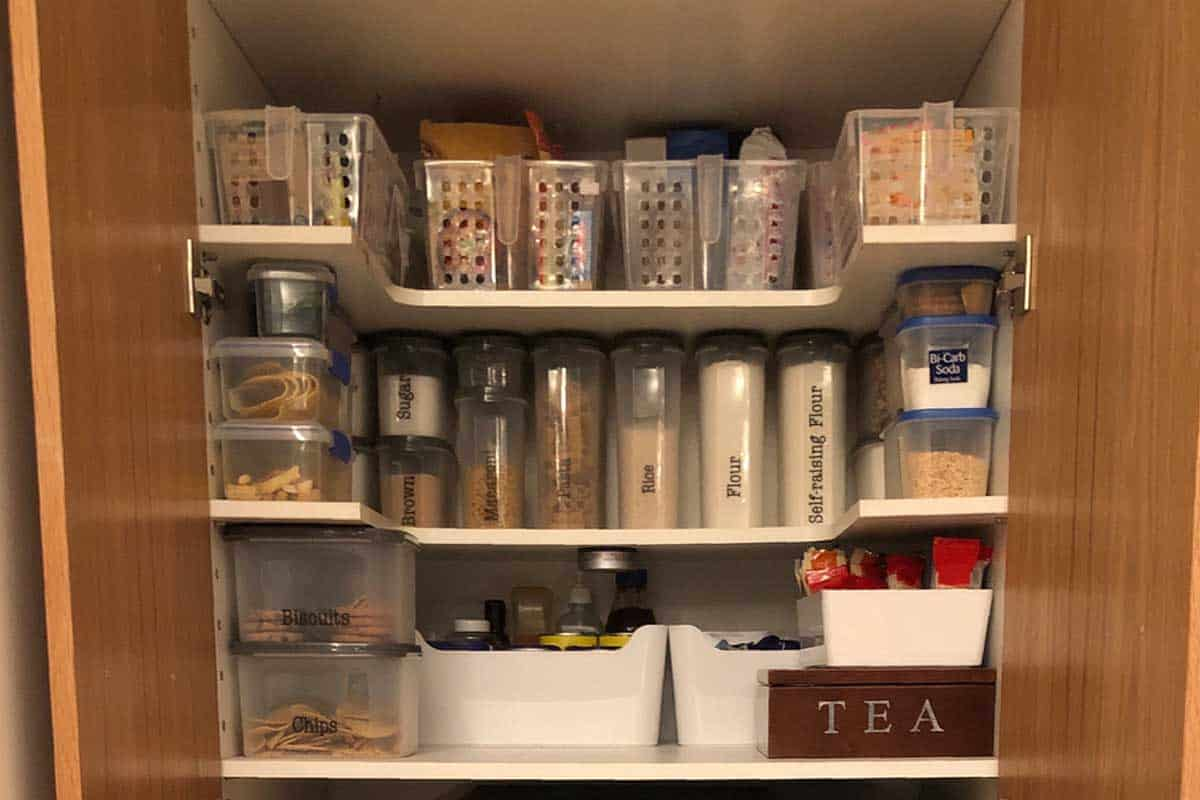 Close up of an organized pantry with snacks and baking ingredients, How To Convert A Closet Into A Pantry [In 6 Steps]