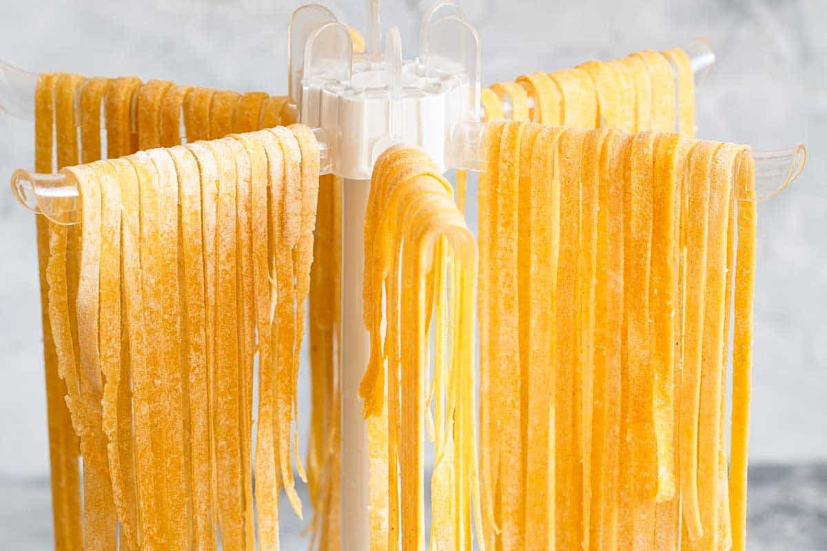Homemade pasta linguine hanging on rack to dry, Do You Need A Pasta Drying Rack? [Here are some alternatives]