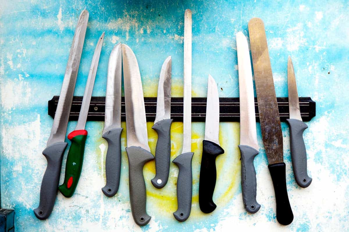 Knives on a magnetic holder row, How To Store a Chef Knife? [3 Must-See Locations]