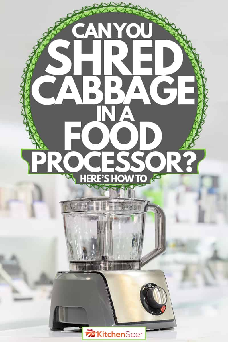 A food processor on a white themed kitchen with other kitchen appliances on the background, Can You Shred Cabbage In A Food Processor? [Here's How To]