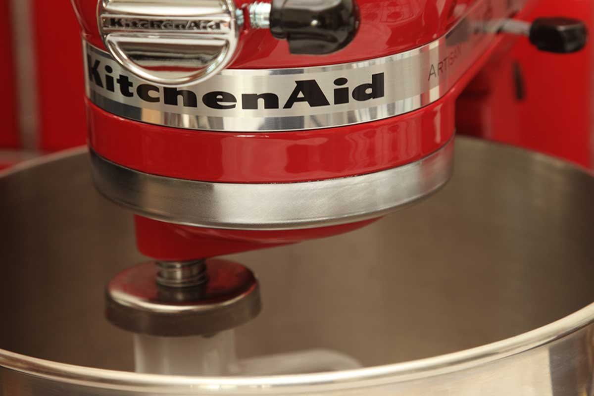 Empire Red coloured Kitchenaid Artisan Stand Mixer with bowl, How Long Do You Knead Bread Dough in a KitchenAid?