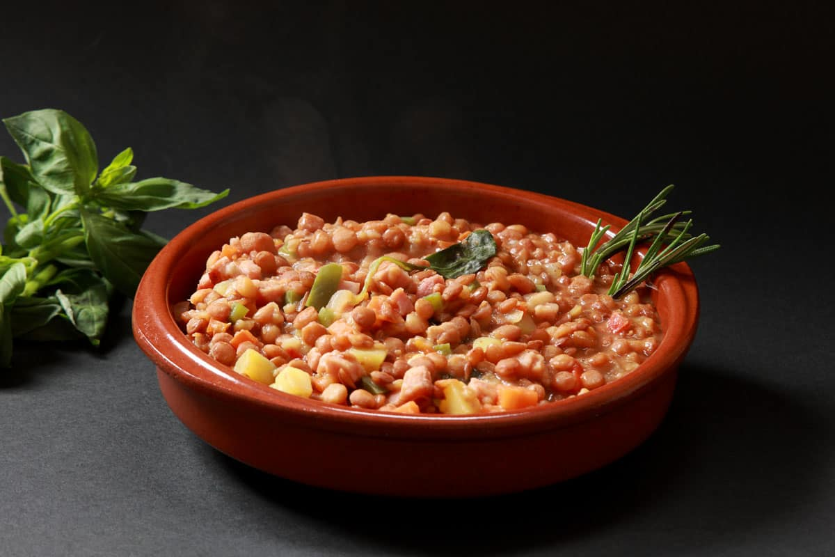 Chickpeas with beef, ham, and vegetable dish on a casserole dish, Can A Casserole Dish Be Used For Serving?