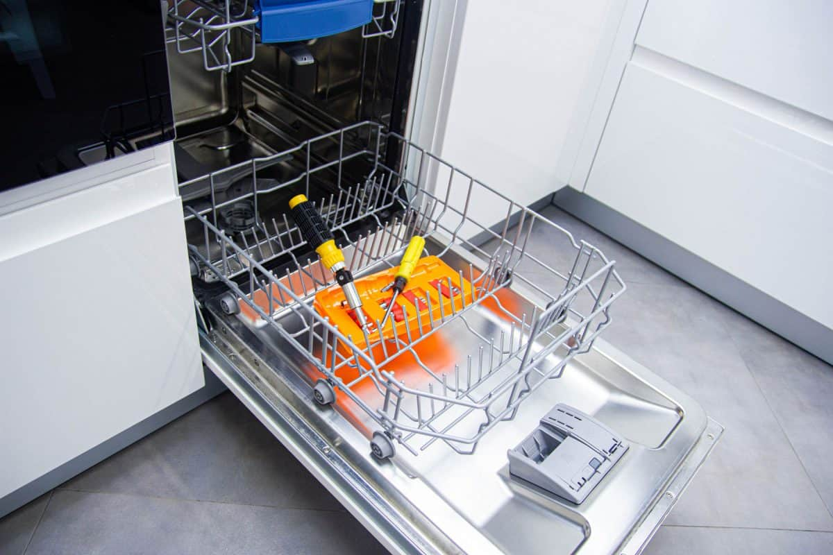 An opened dishwasher due to a broken dryer, Bosch Dishwasher Not Drying? Here's What To Do