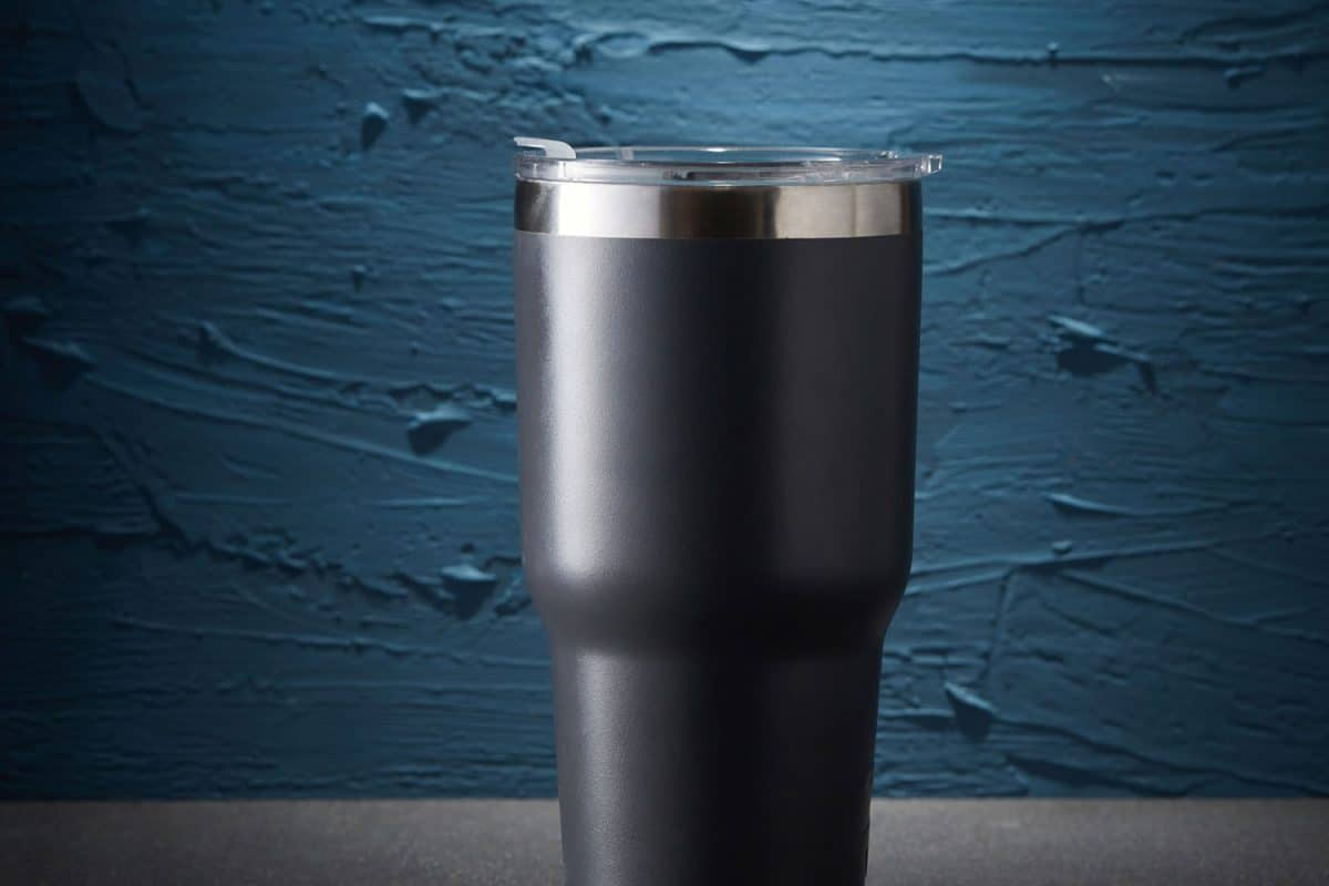 Black Cold Cup or Steel mug on rough background, Are Yeti Cups dishwasher safe?