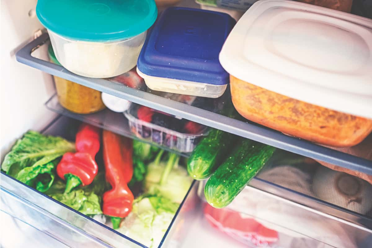 Fresh vegetables in the fridge inside plastic food containers, Can You Recycle Plastic Food Containers? (Inc. Take-out Containers)