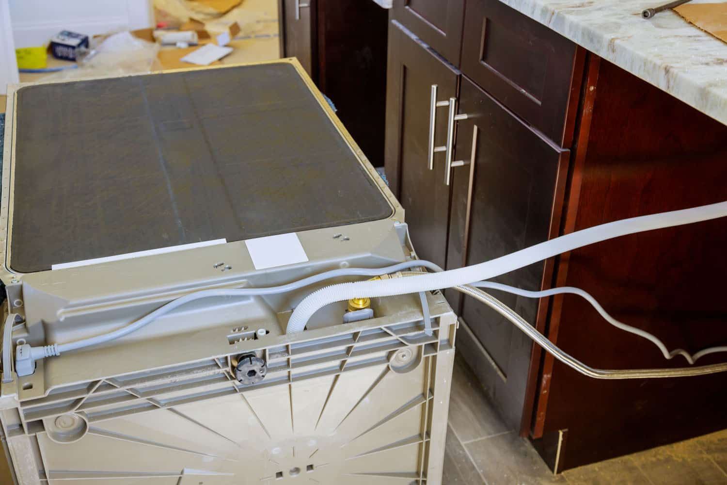 Installation hoses for dishwasher machine domestic connection plumbing pipes in kitchen
