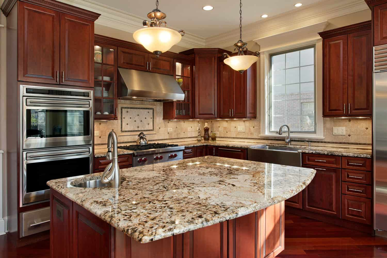 Kitchen with granite island and cabinets