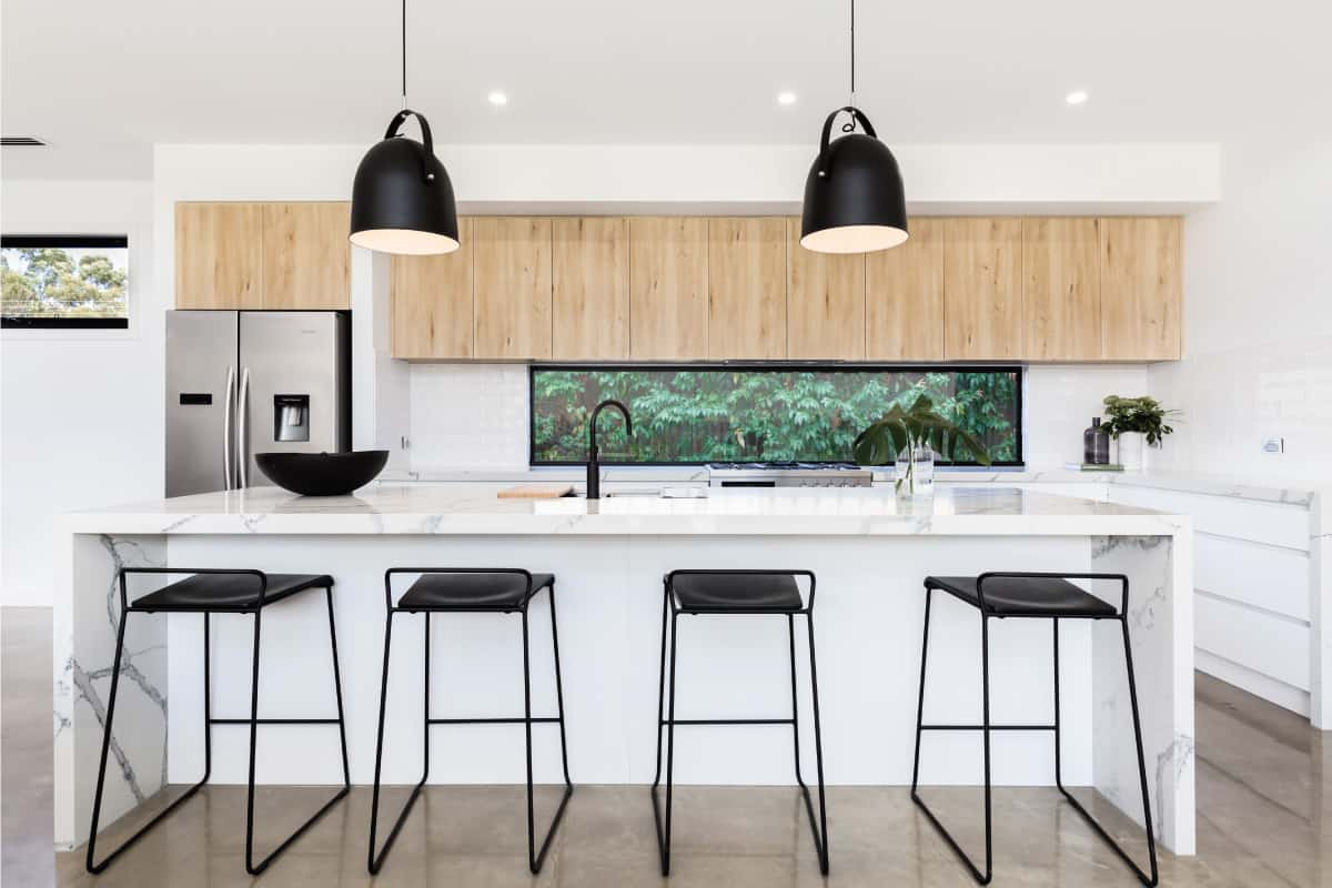 Large white luxury Australian kitchen with marble waterfall island, Where To Put Outlets In A Waterfall Island