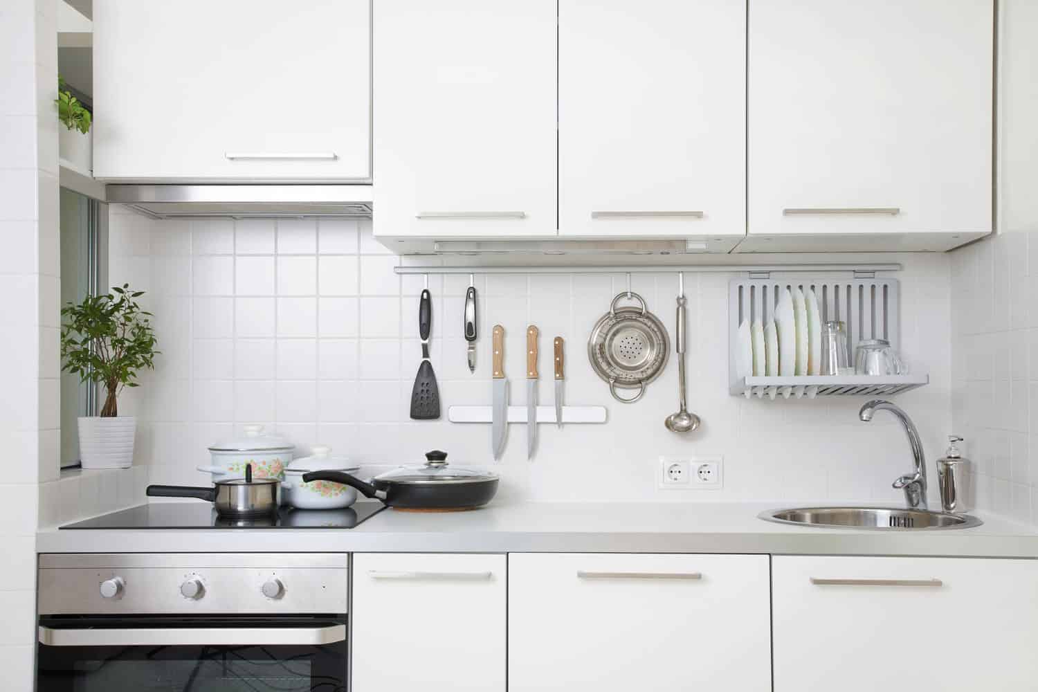 Modern kitchen with utensils and cabinet