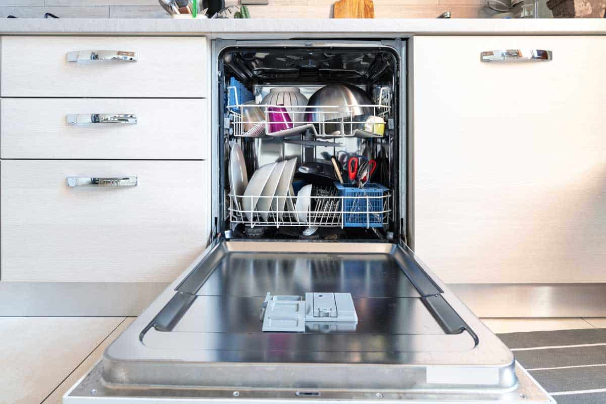 Opened dishwasher with clean dishes, How Heavy Is A Residential Dishwasher