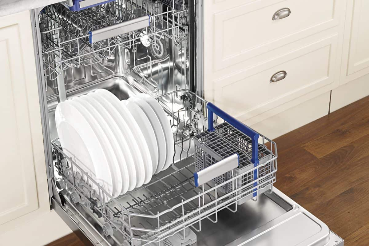 clean dishes in an open dishwasher in domestic kitchen, What's the Typical Dishwasher Height? (Inc. ADA Dishwashers)