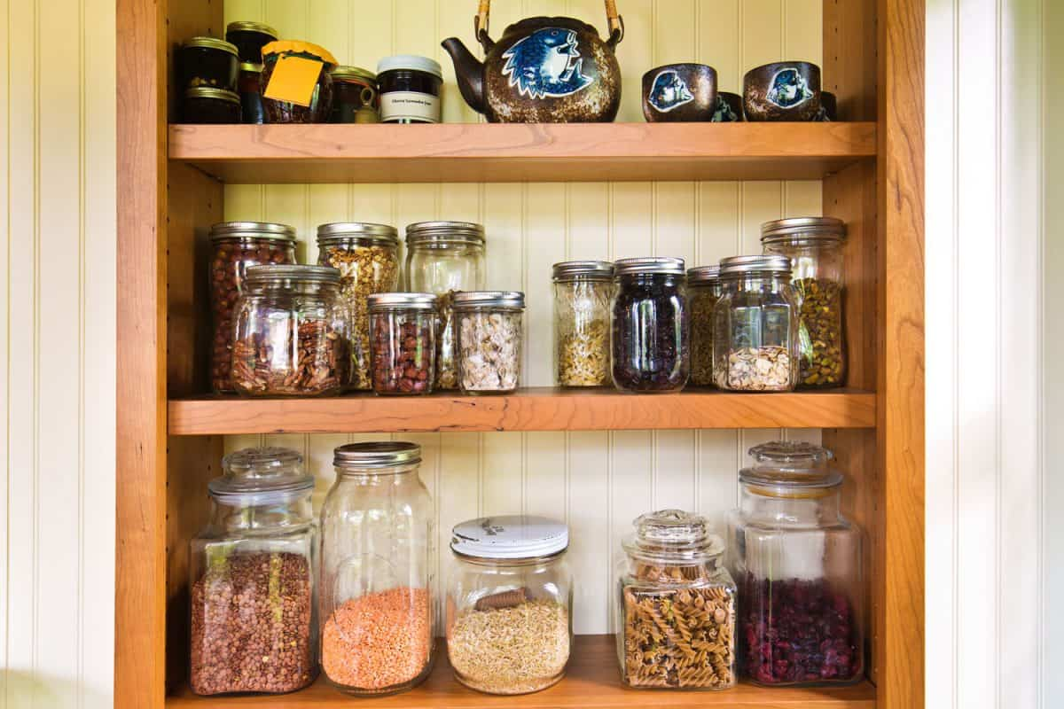A contemporary classic kitchen renovation remodeling featuring a pantry storage shelf and maple cabinet