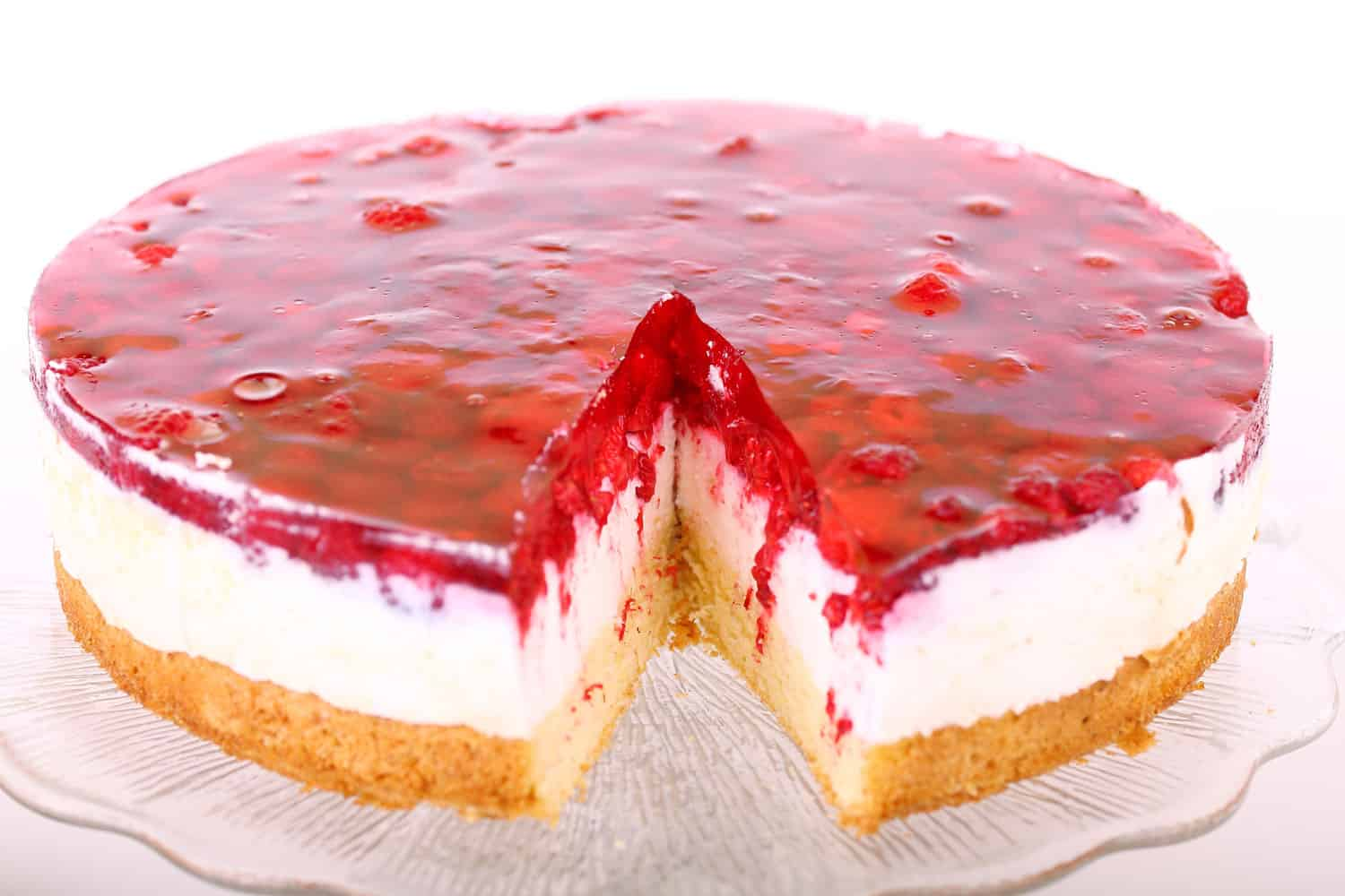 Raspberry cheesecake on a glass serving plate