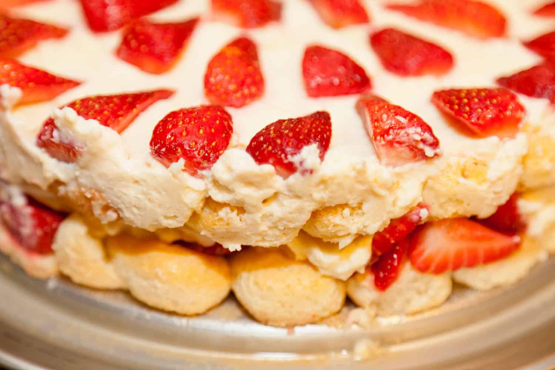 An up close photo of a strawberry tiramisu cake