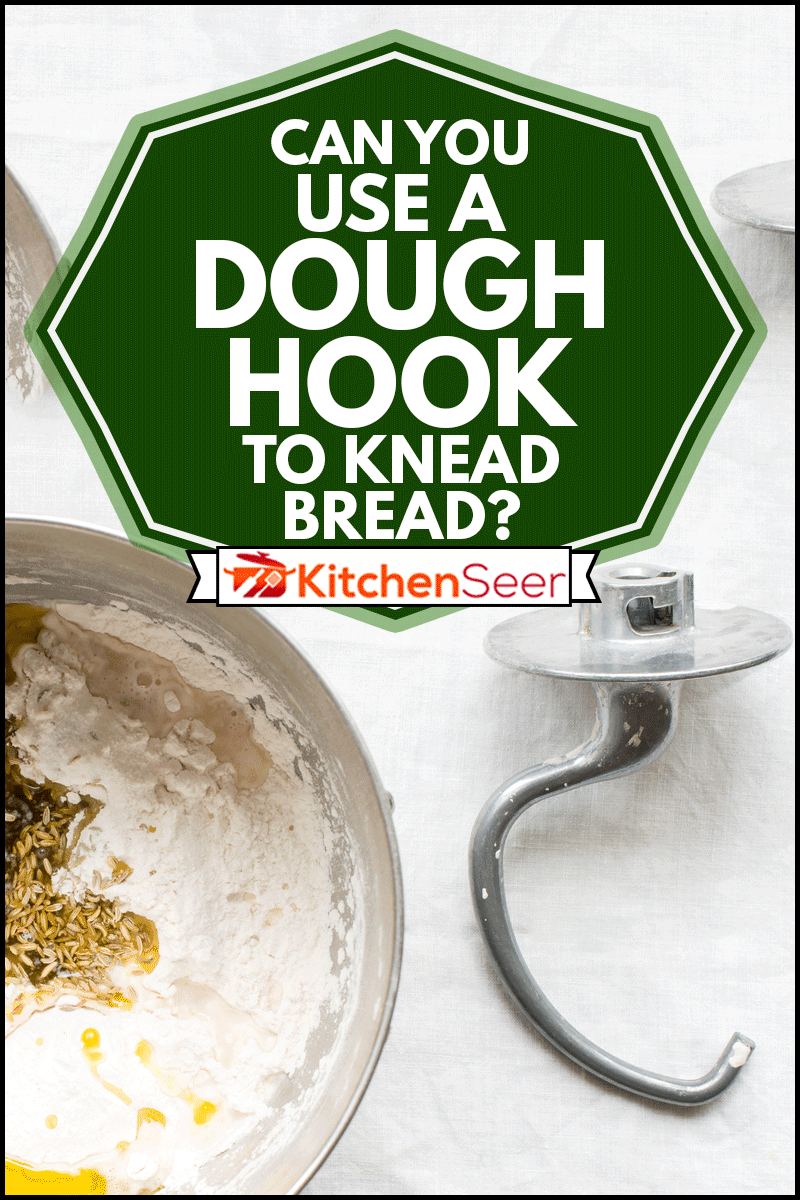 Mixer dough hook attachment on side, on white linen table cloth, Can You Use A Dough Hook To Knead Bread?