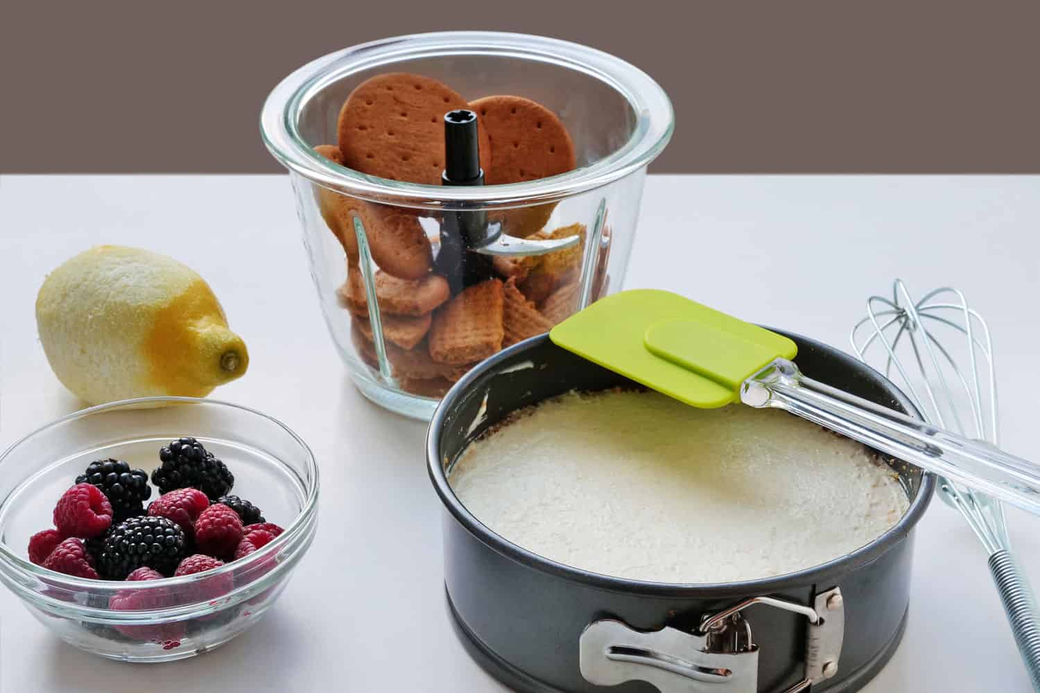 Ingredients for a delicious cheesecake on a springform pan