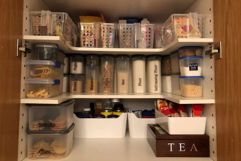 Organised pantry items on white pantry shelves