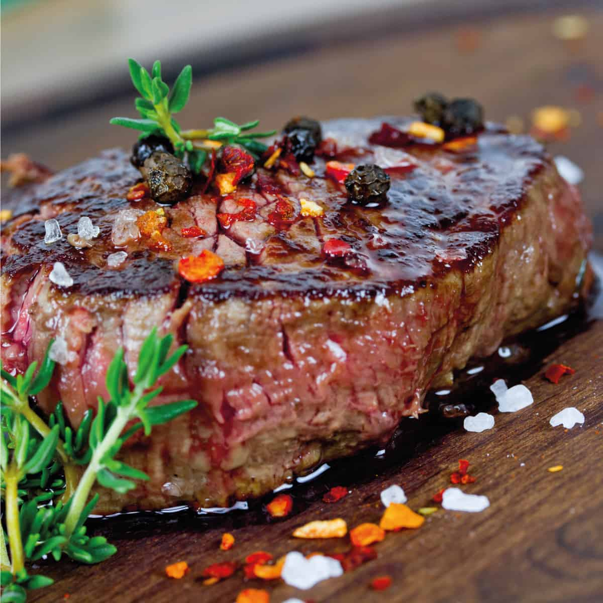 Seared meat for steak topped with herbs and spices