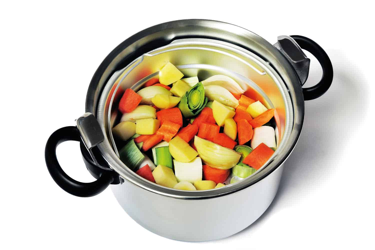 Stainless steel pressure cooker with vegetables