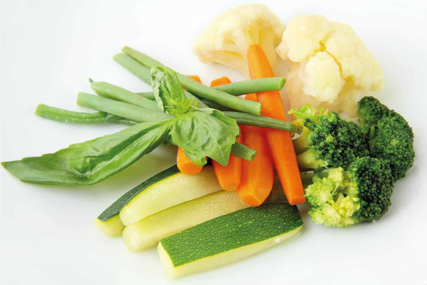 Steamed sliced carrots, brocolli, cauliflower, zucchini and beans